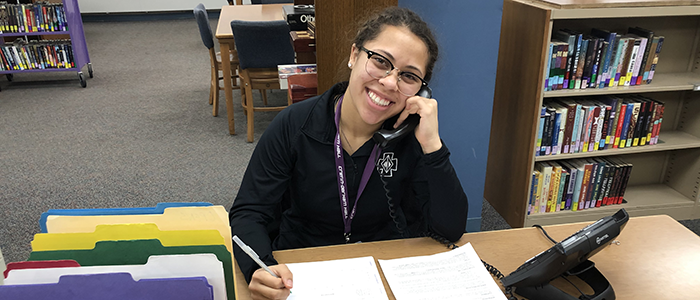 Juliana Cruz '22 is all smiles while she connects with alumni.